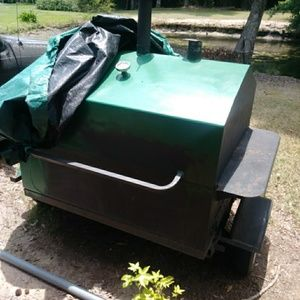 Propane and charcoal grill on wheels